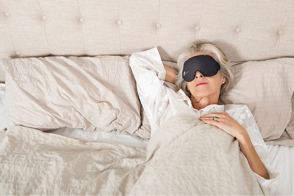 Woman sleeping with Rayless Mask
