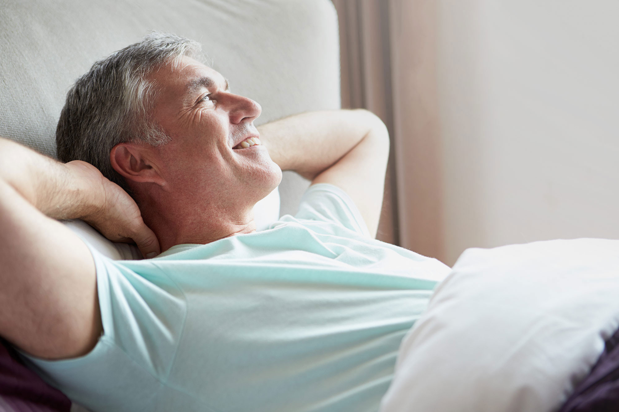 Happy man waking up refreshed