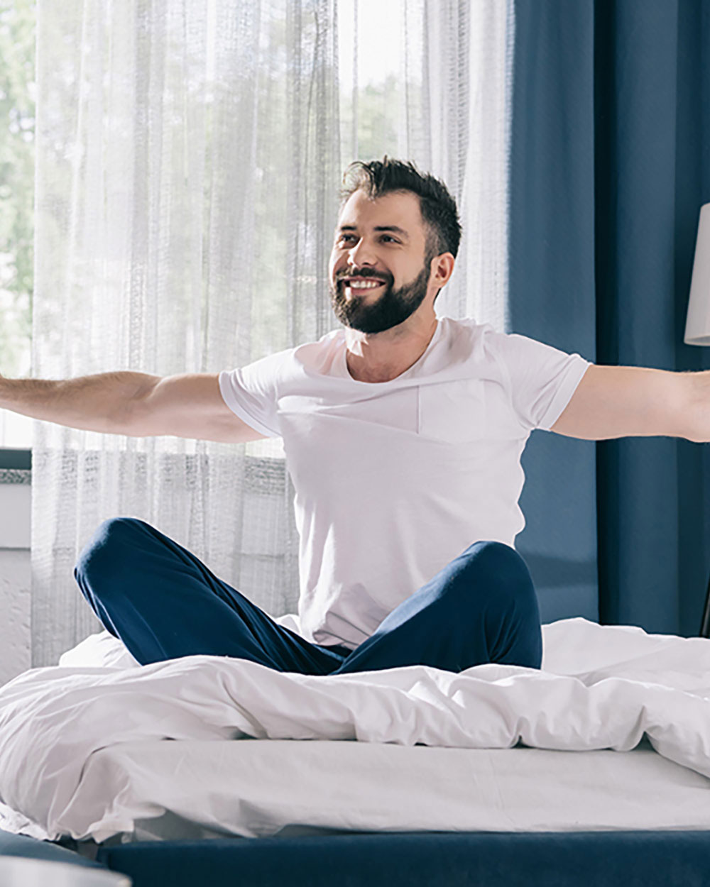 Image of Man Waking Up Refreshed and Happy